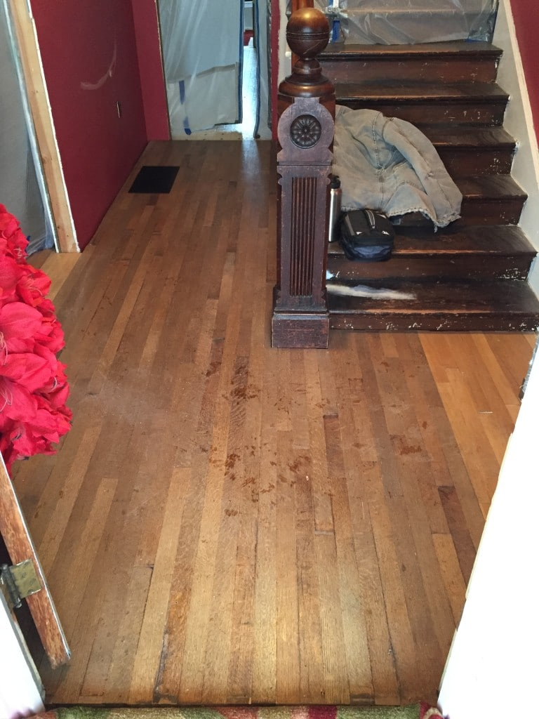 Hardwood flooring re-installed prior to sanding and staining.
