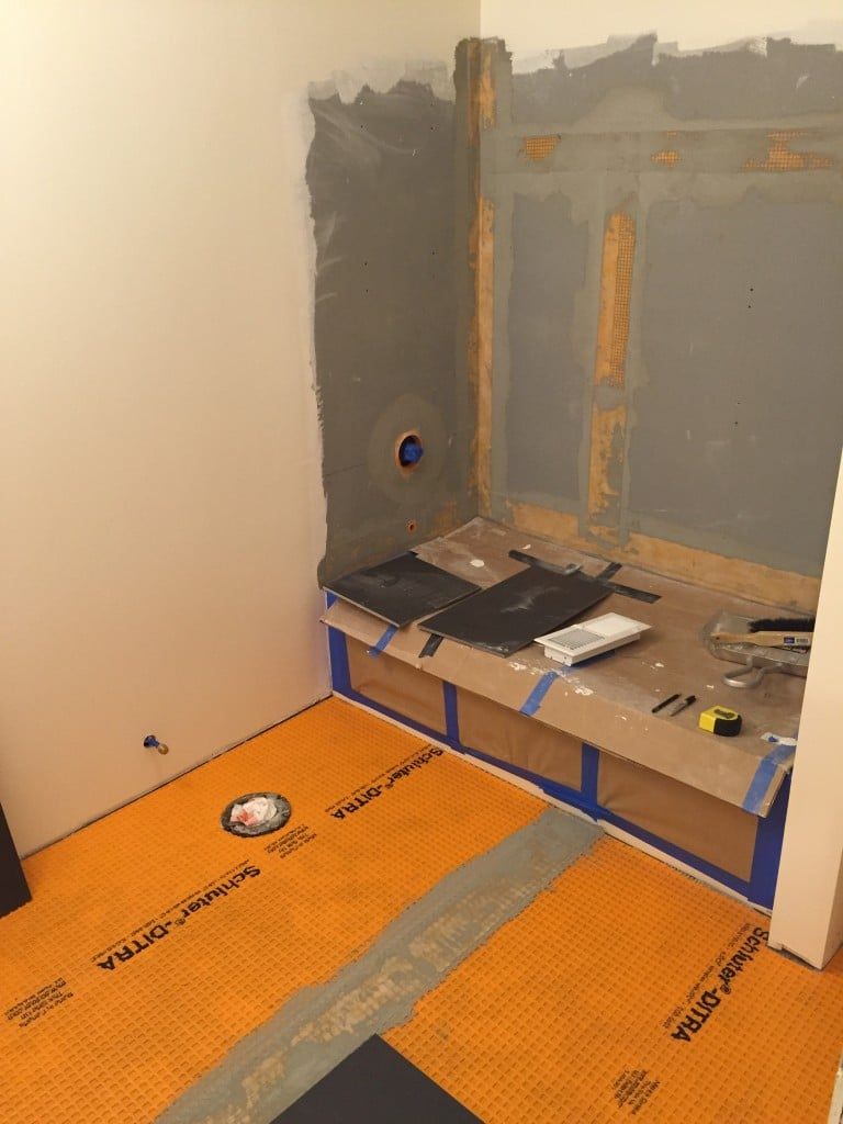 Here we prepared the bathroom floor and shower stall for tiling