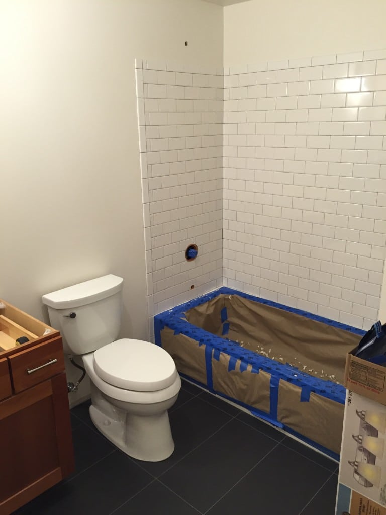 After the floor was tiled we then tiled the shower/bathtub with a subway tile